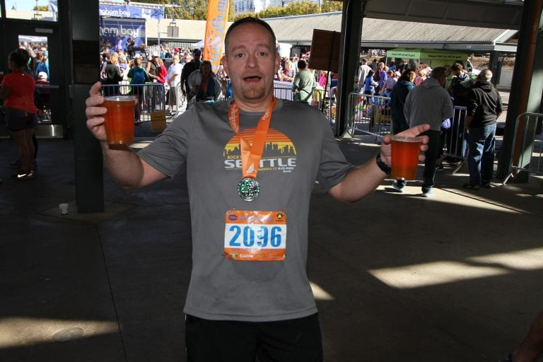 Runner holding beers post race