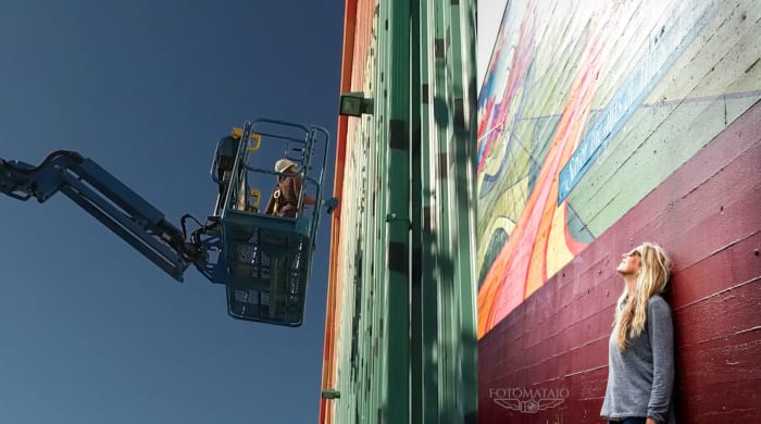 Gretchen Leggit painting mural in cherry picker before and after